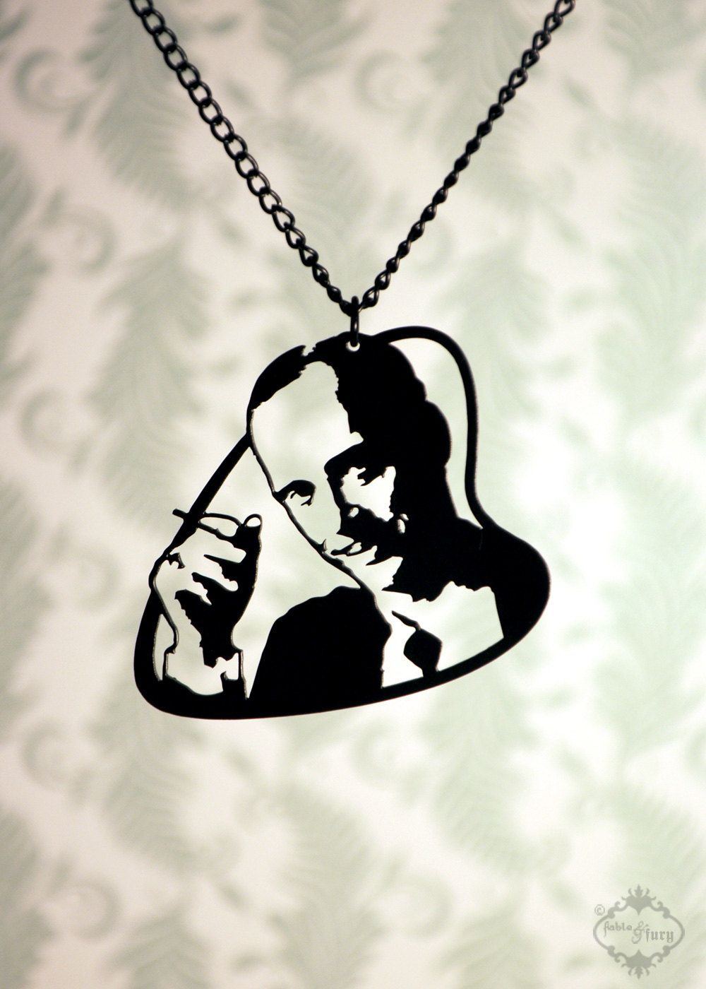 John Waters tribute silhouette necklace, portrait pendant in black stainless steel - cult film geekery. $32.00, via Etsy.