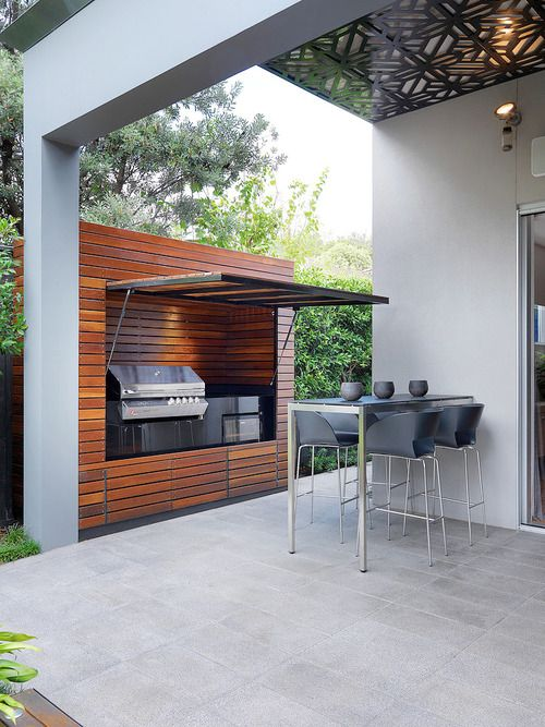 The barbecue and wood wall.