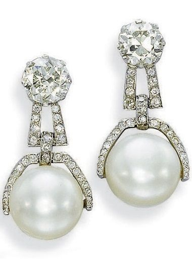 b0e51bbc9017 The two button-shaped pearls measuring 13.45-13.50 x 11.50 and 13.25-13.30  x 10.90 to the pavé-diamond half surround and surmount