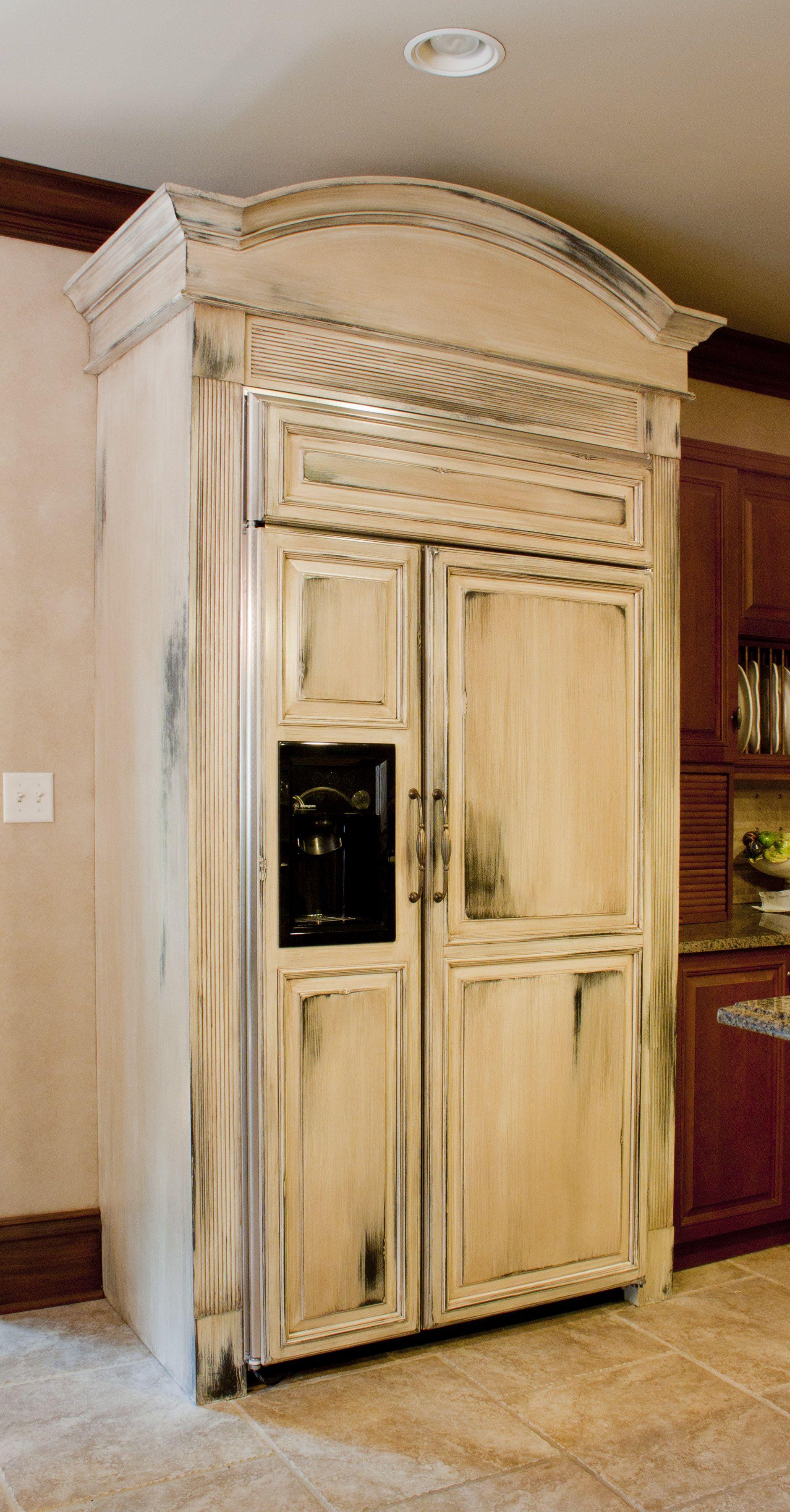 Muti Layer Distressed Paint And Glaze Finish On Paneled Refrigerator