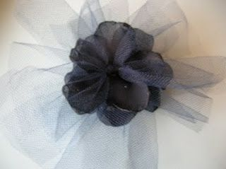 Tulle & fabric flowers, obviously not this color :)