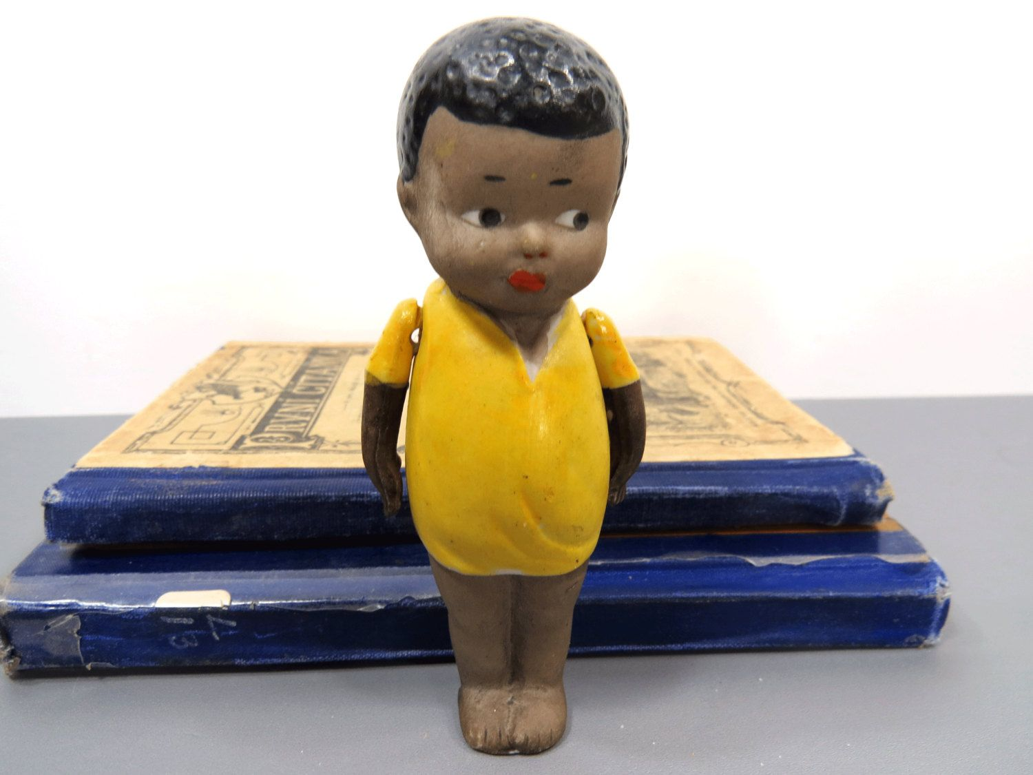 Black and yellow hair boy nippon black americana bisque boy doll  movable arms frozen legs