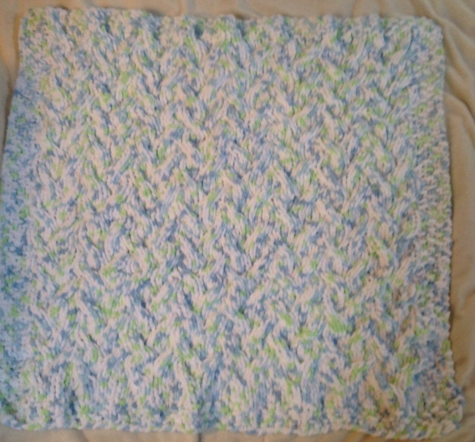 Bernat Baby Blanket Knitting Patterns : Cable Baby Blanket - Knit with Bernat Baby Blanket Yarn in Funny Prints. Easy...