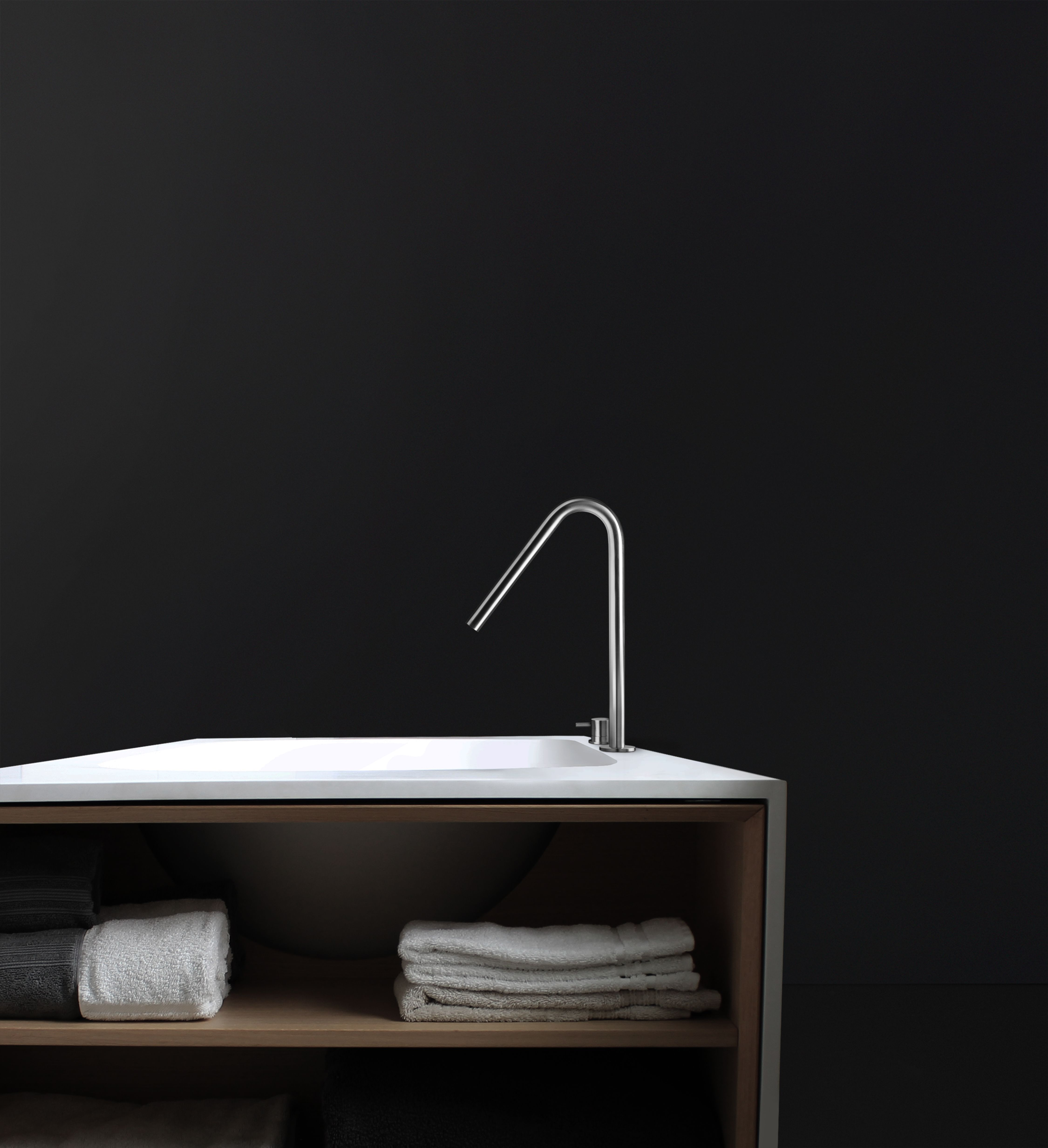 Stainless steel single-hole, deck-mount tubfiller spout Co-ordinating with the INOX stainless steel tapware collection, this modern tubfiller adds an elegant touch to the bathroom with its unique swan-neck spout design.