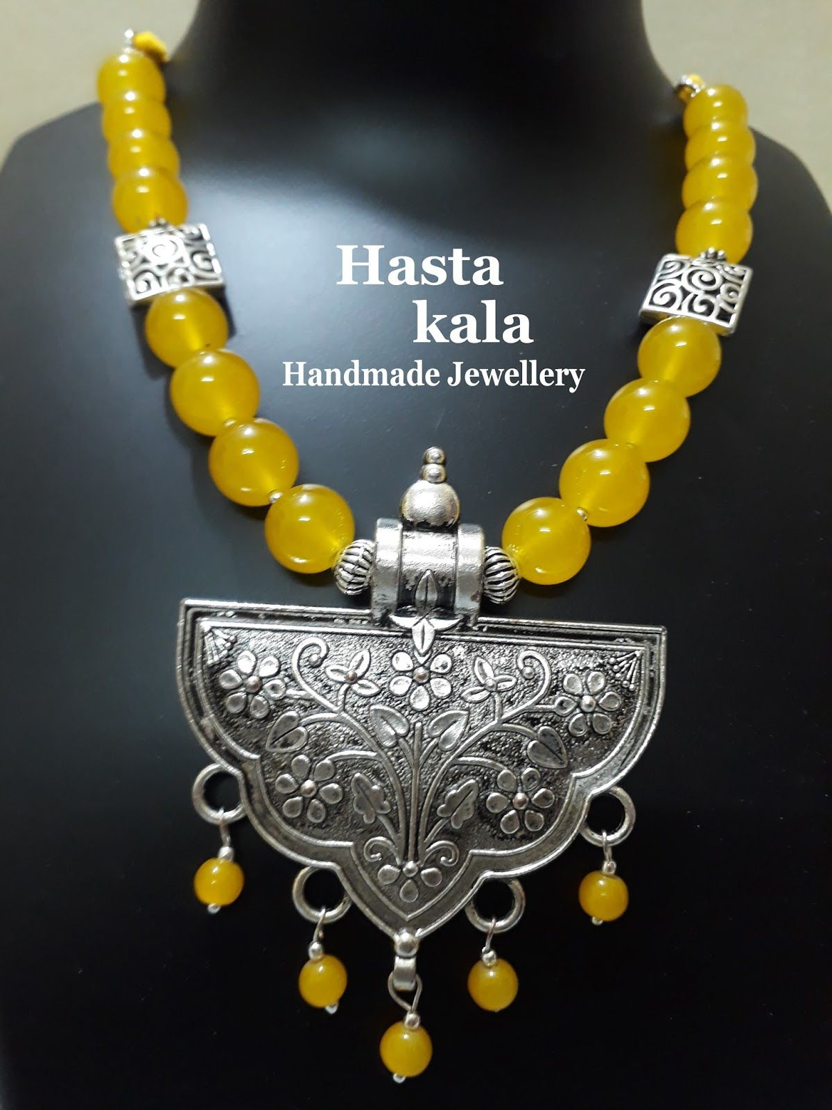 A Yellow Colour Glass Beads Necklace With German Silver Pendant