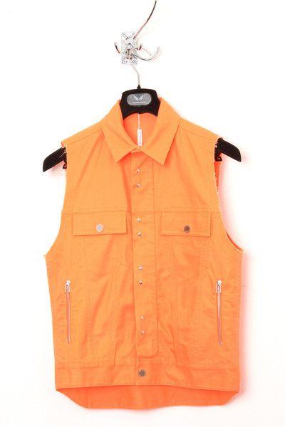 UNCONDITIONAL neon orange sleeveless denim jacket.