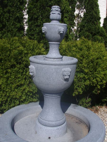 Add a classical element to your landscape. Hand-carved from natural stone, this Charcoal Grey Granite 2-Tiered urn fountain by Carved Stone Creations features a simple yet elegant 2 urn design with classic lion head spitters and an included basin. $3,744  Click on the image to see it in our online store.  #fountains