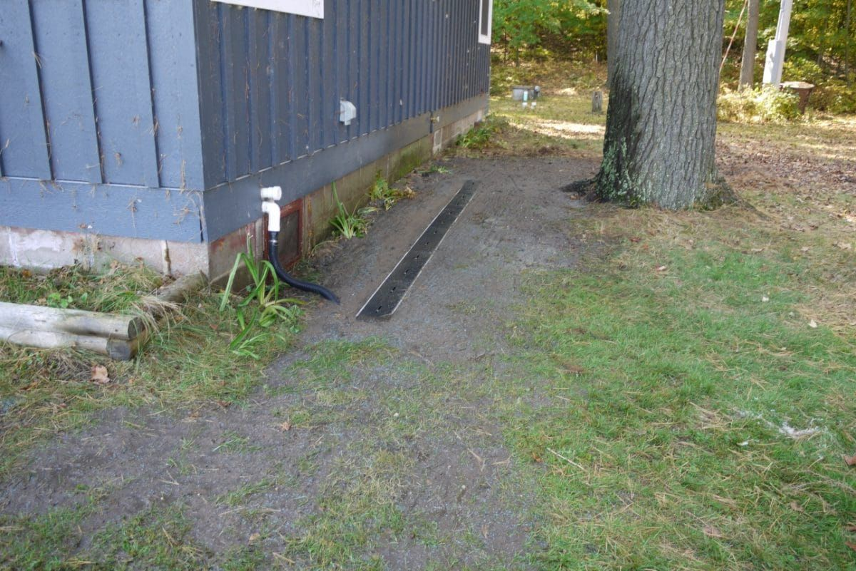 Grass Seeding Over And Around Surface Yard Drain For In Ground