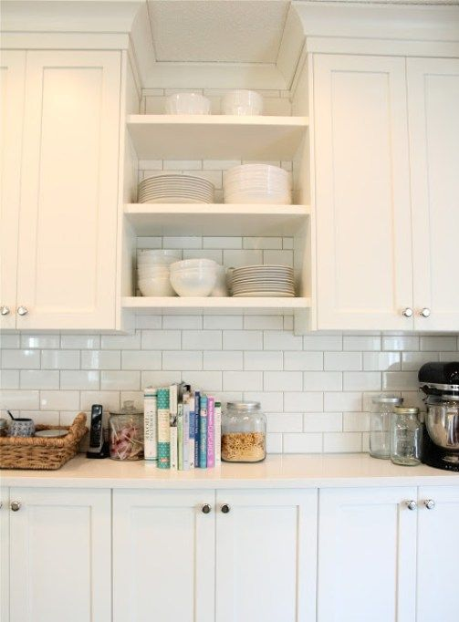 The best white or off white paint colours for cabinets include Cloud White.  Shown in kitchen with subway tile backsplash and open shelves and white ...