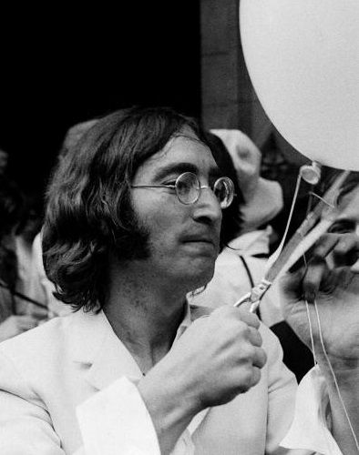 """John releasing 365 balloons at the opening of his exhibit,  """"You Are Here"""" held at the Robert Fraser Gallery in the Mayfair district of London. The exhibit was held at the gallery between July 1 - August 3, 1968  I Photo Credit:  Andrew MacLear"""