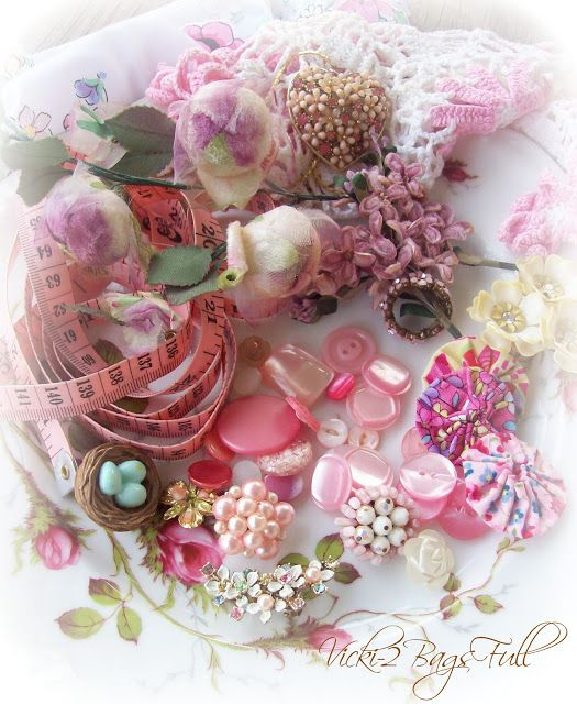 a minature collection of vintage buttons, jewelry,millinery, and sewing notions.
