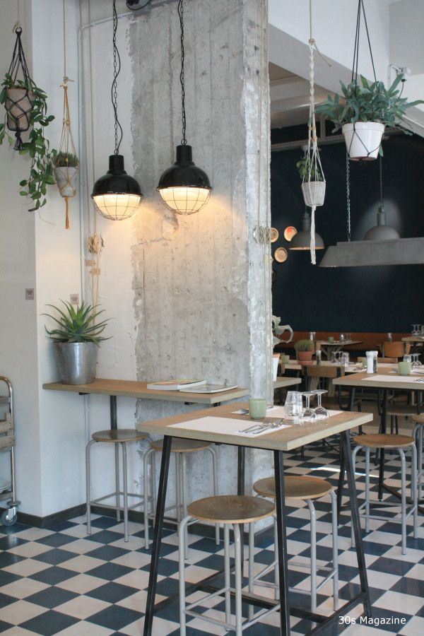 industrial cafe with hanging plants - Gray Cafe Interior
