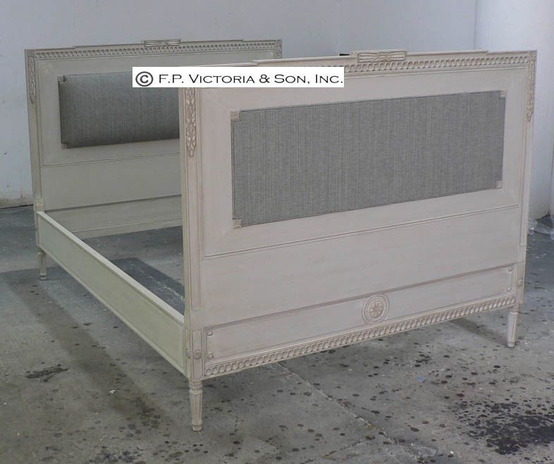 A custom bed frame with upholstered panels