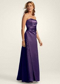 This beaded strapless satin ball gown is a classic silhouette. The organza beaded inset adds a glamorous touch to the all over satin look. This is a dramatic look that is sure to turn heads.