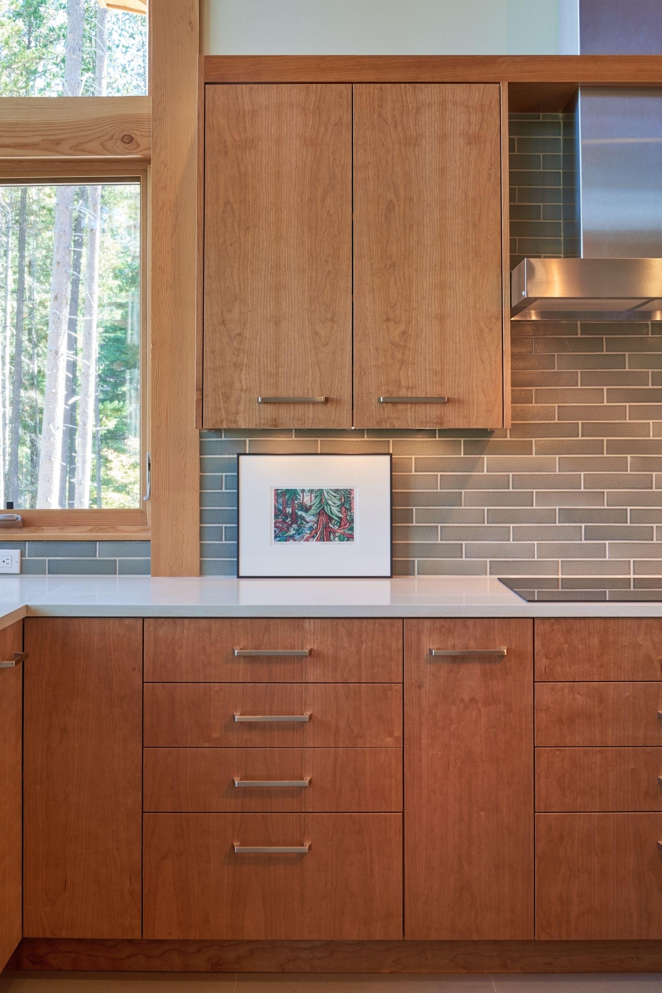 Vertical grain cherry cabinets and cream-colored quartz ...