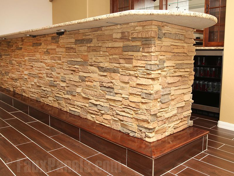Attrayant These Faux Stone Bar Panels Complement The Tile Flooring And Granite  Countertops.