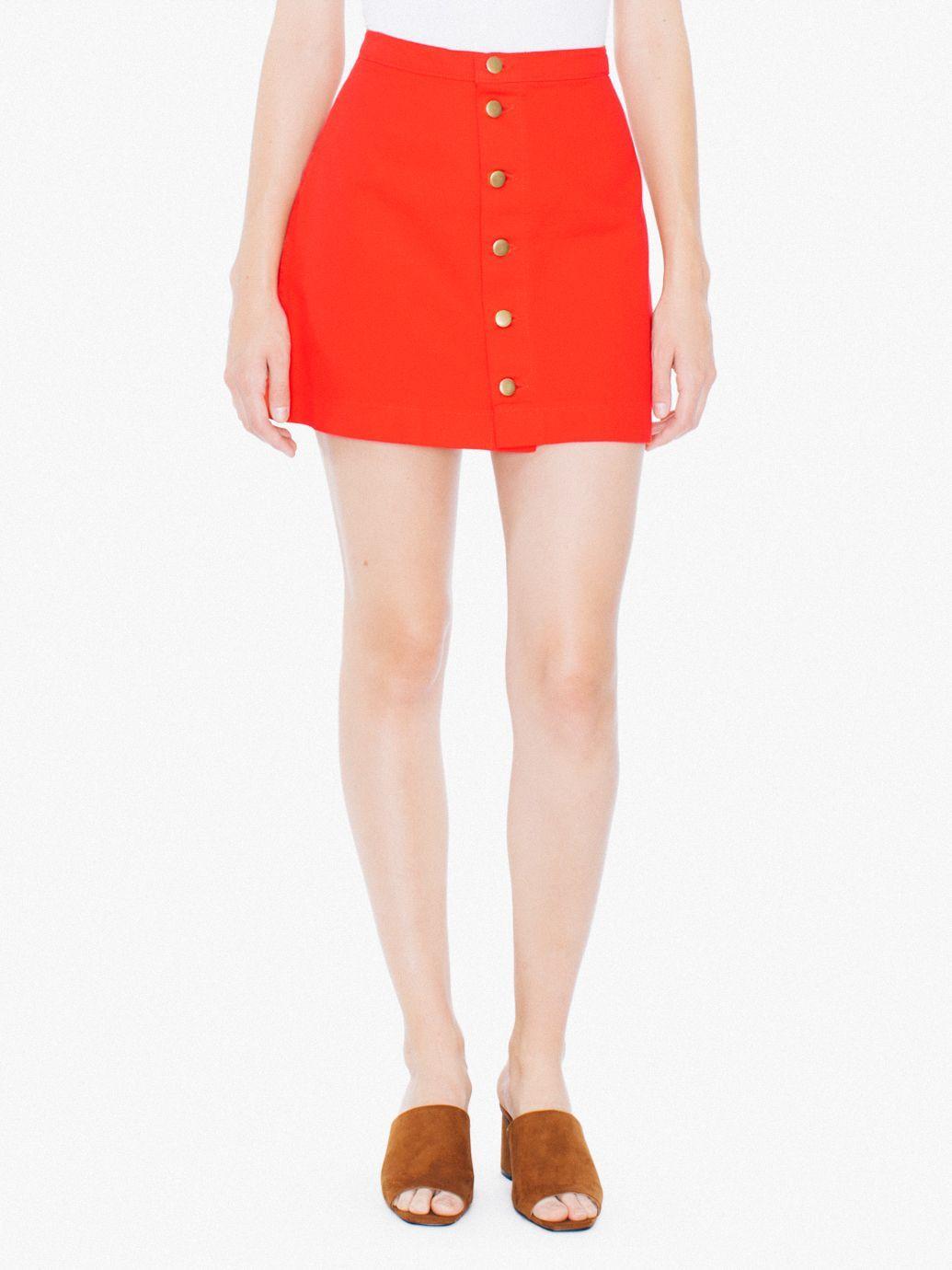 Denim mini skirt featuring 6-button front, high waist and A-line design.