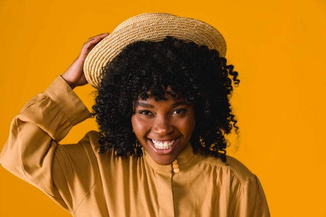 Young Black Woman Toothy Smiling And Holding Straw Hat Young Black Women Straw Hat