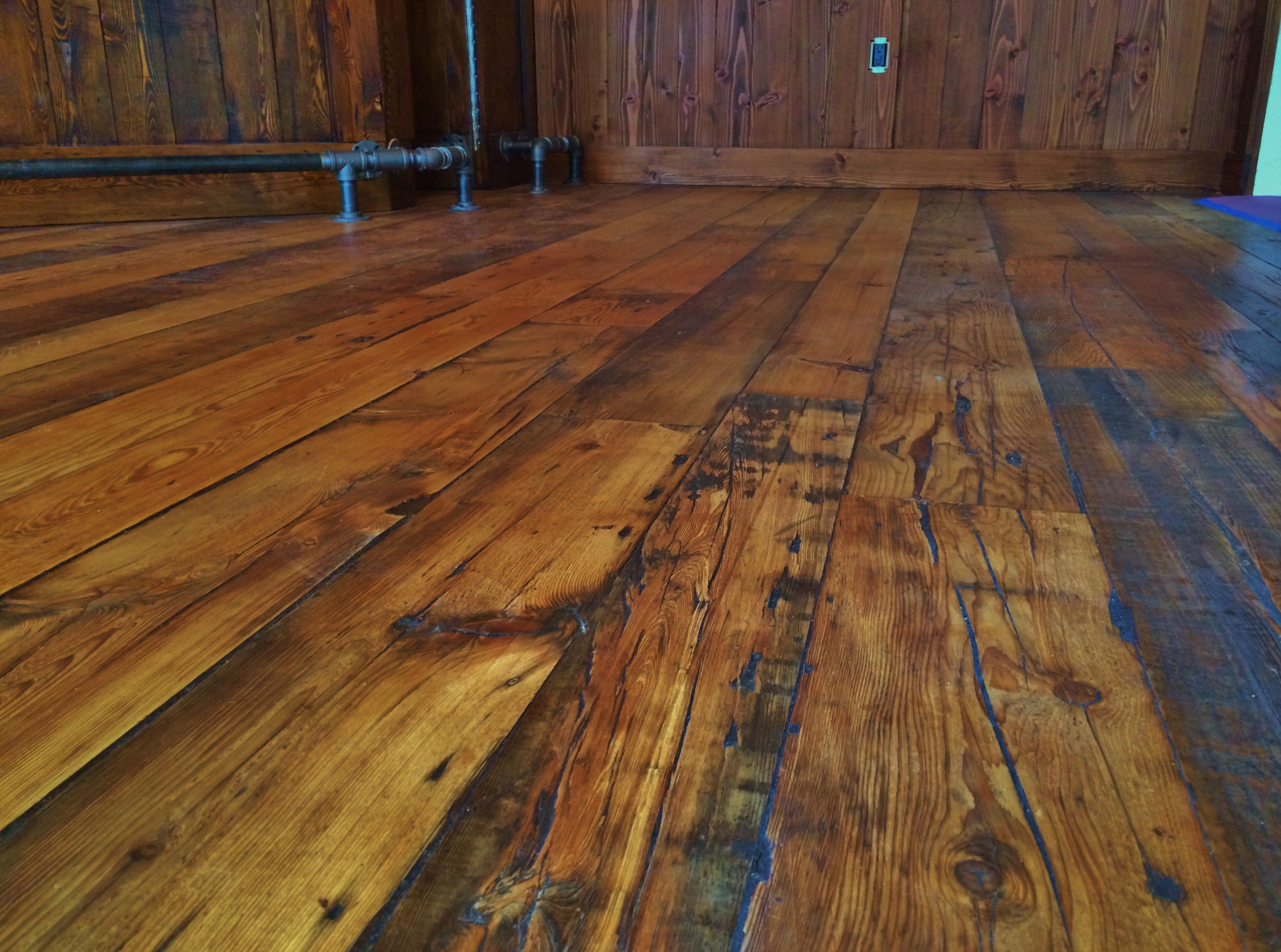 Reclaimed Wide Plank Hemlock In A Customer S Bar Area Douglas Fir Wainscoting In The Back Wood Floors Wide Plank Wide Plank Wood Floors