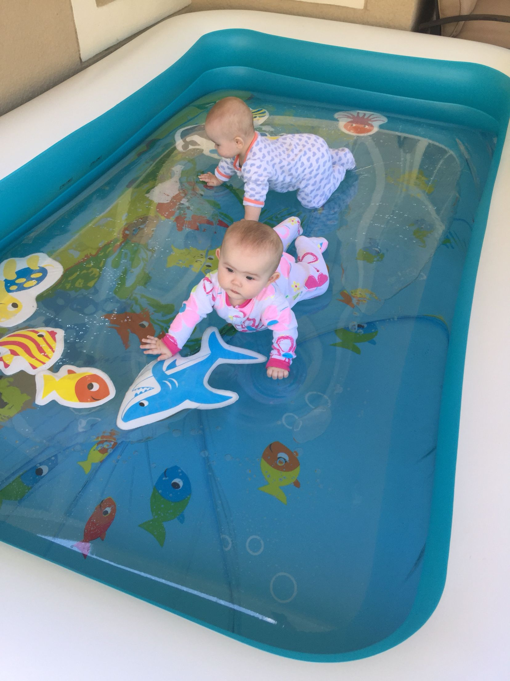 Put the water blob inside a blow up pool for little ones to play on!