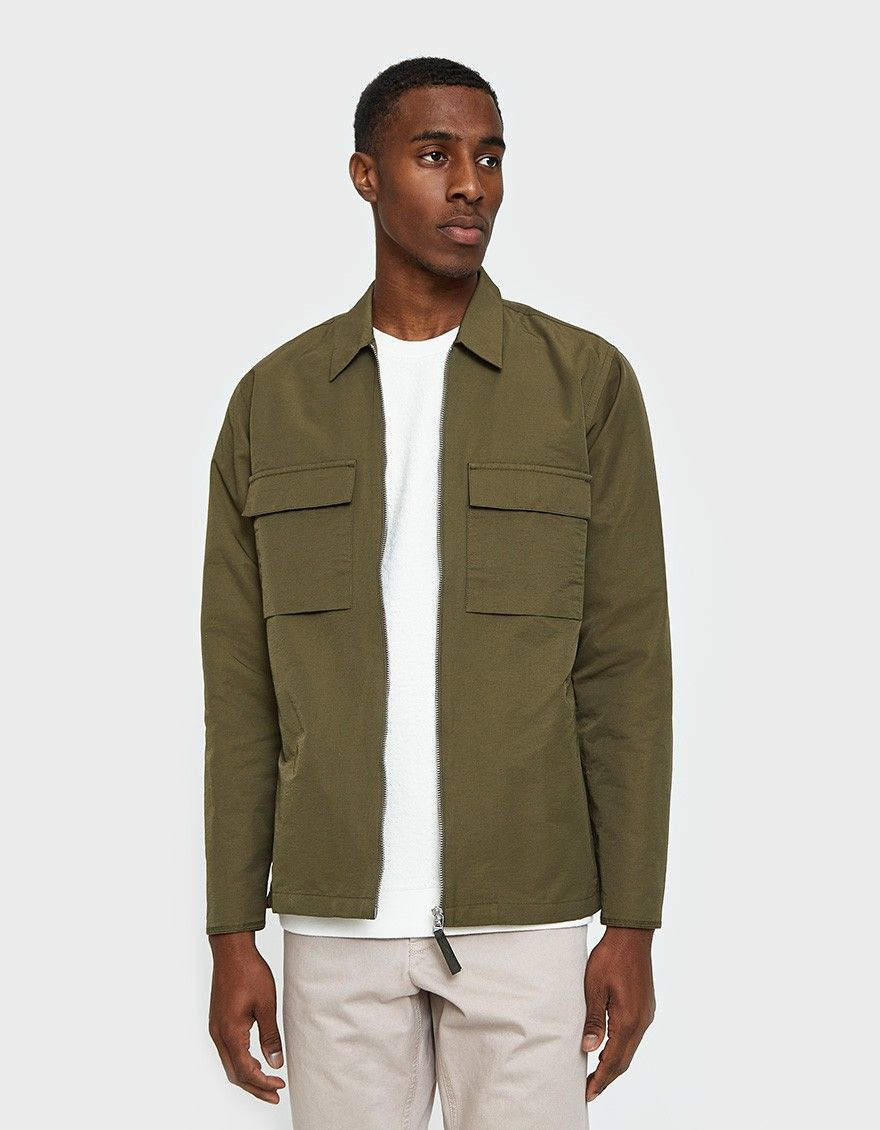 e474b161 Military-inspired zip up shirt from Norse Projects in Lichen. Spread  collar. Full zip front closure. Two chest pockets with flap and snap button  closures.