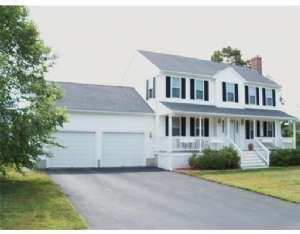 Classic Gable Front Colonial With Farmers Porch 2 Car Attached Garage Situated On A Private