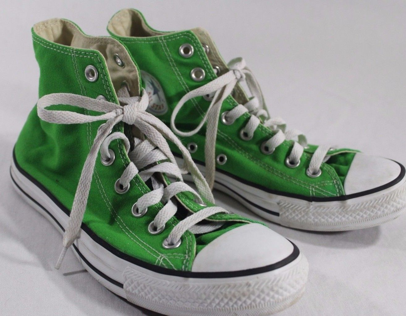 bright green converse high tops