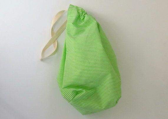 This handy green and white drawstring bag with candy stripes is ideal as an easter basket or childrens party bag. The green and white striped pattern