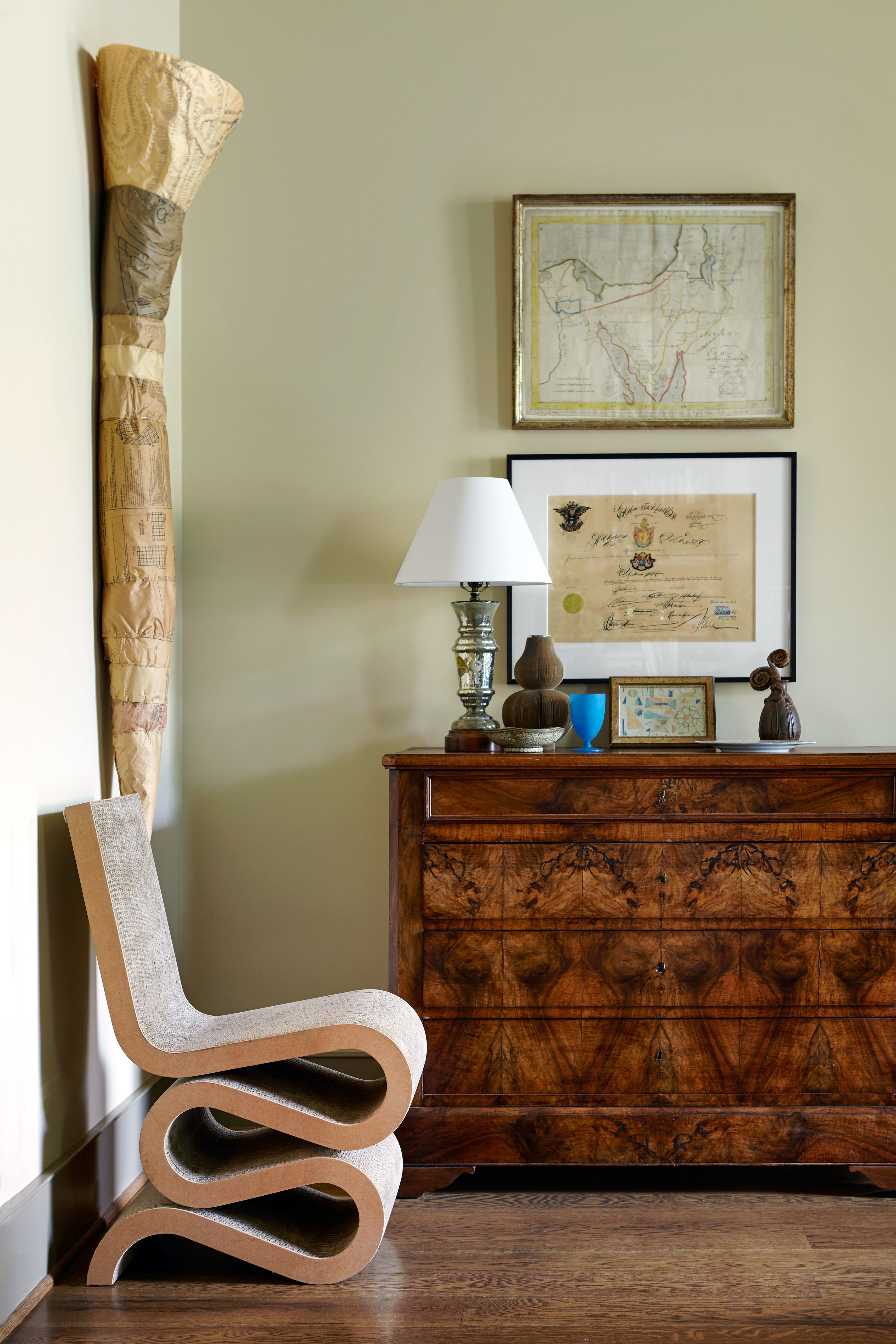 A Living Room Design That Features Antiques From Around The