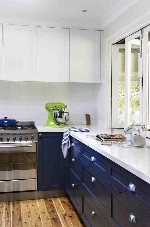 Beautifully Appointed Blue And White Kitchen Boasts Navy Blue Cabinets Fitted Wi Kitchen Cabinet Styles Modern White Kitchen Cabinets Kitchen Renovation Design