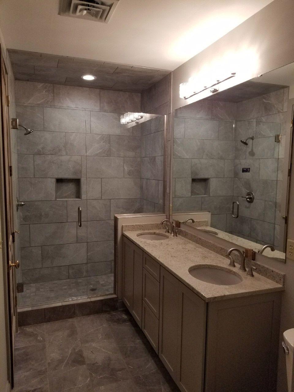 Modern bathroom design complete with custom glass