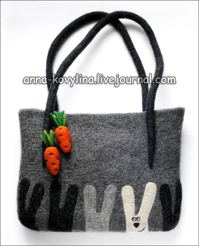 photo of a felt bag with bunnies and carrots - sorry; I´ve searched for the source and look the whole site: http://anna-kovylina.livejournal.com/ but couldn´t find it.