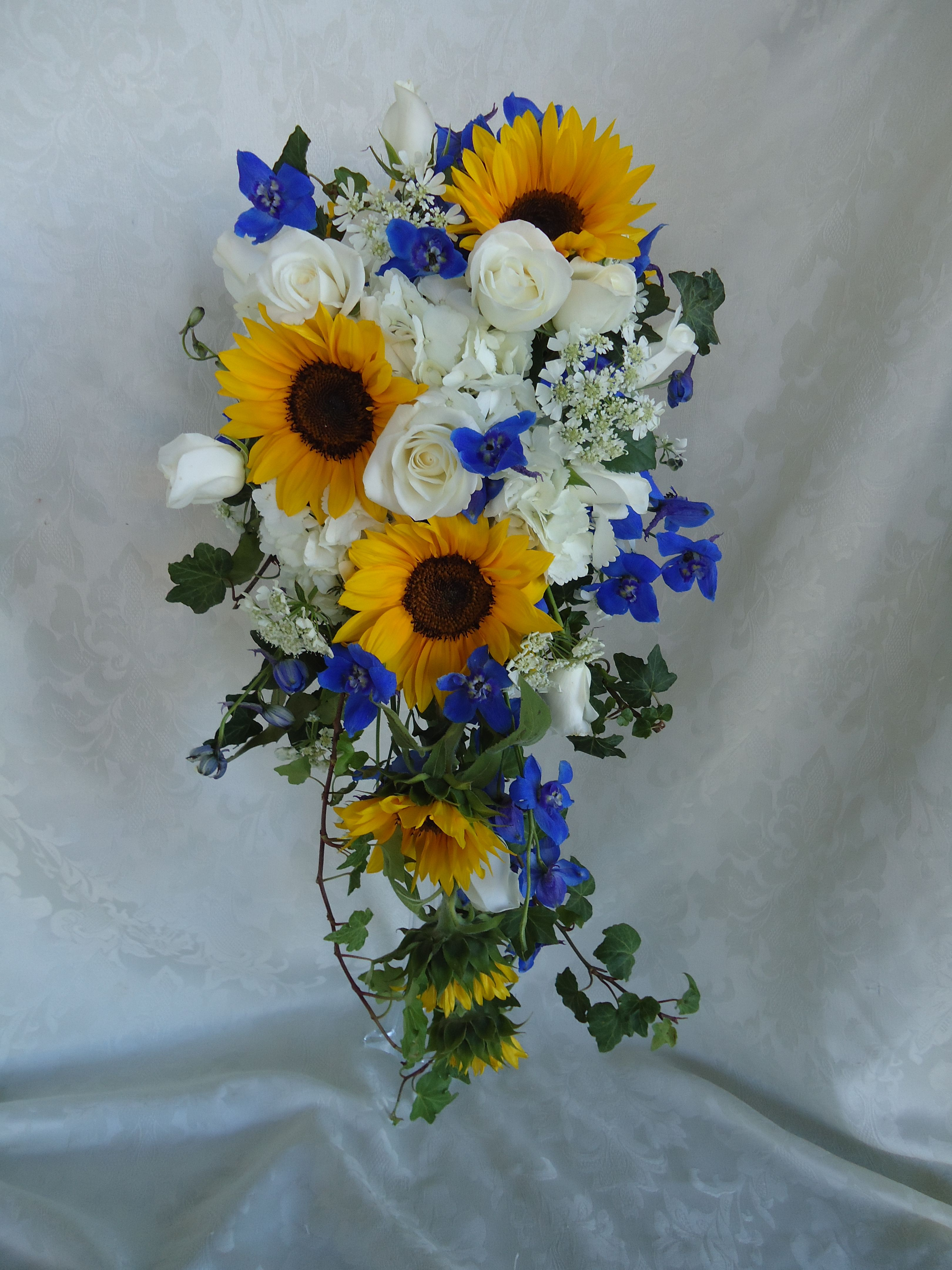 4dd030c58fce0 Wedding Flowers: Cascading bridal bouquet with colorful yellow ...