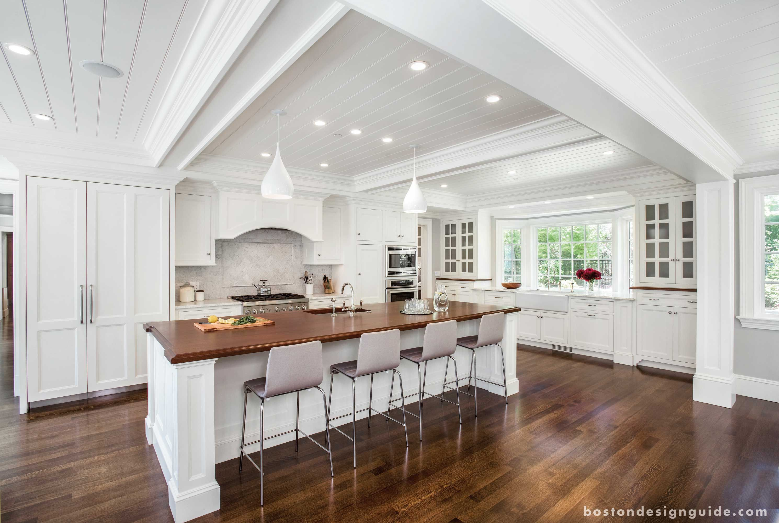 White Kitchen With Hardwood Floors Fallon Custom Homes