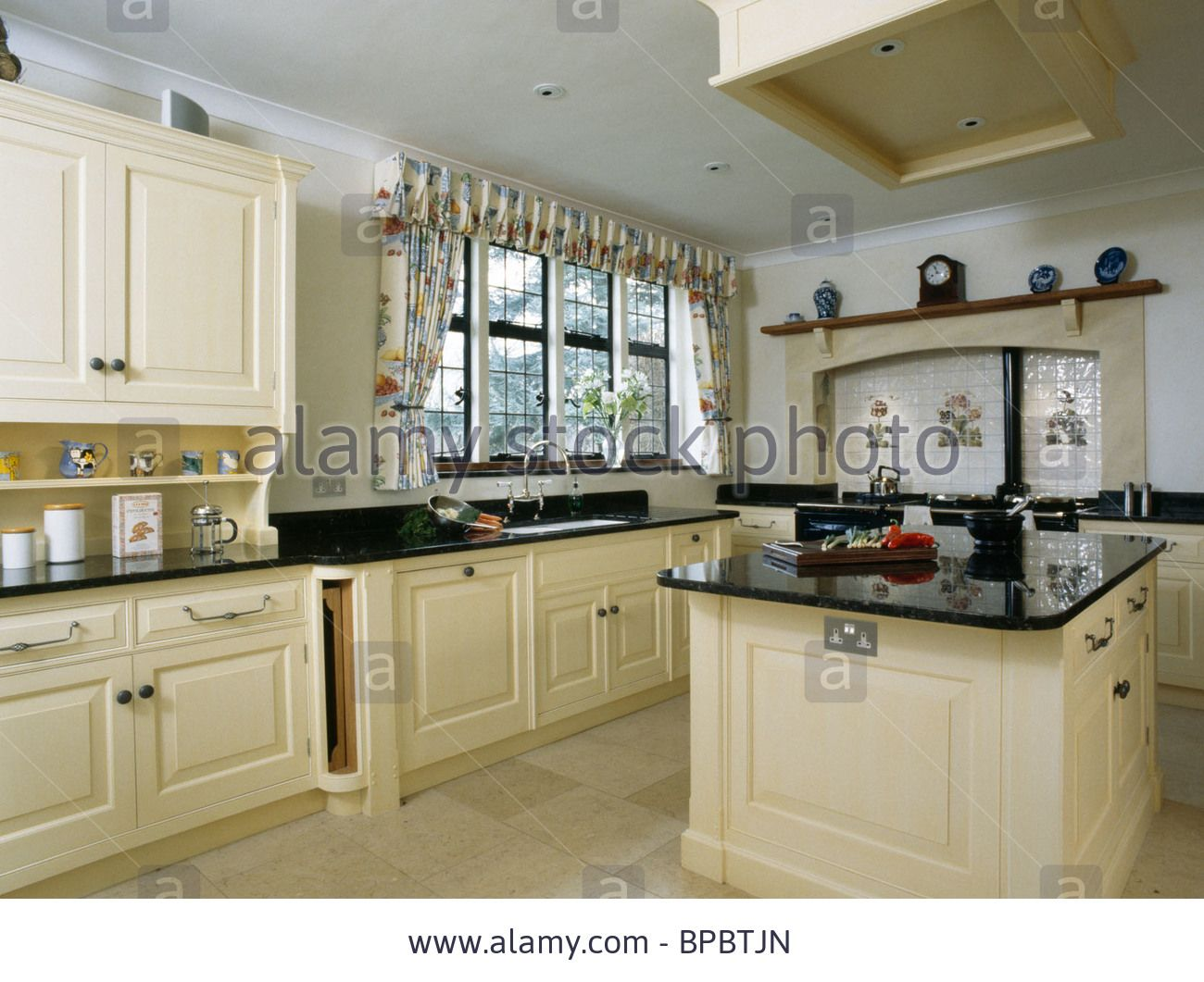 Stock Photo Cream Island Unit With Black Granite Worktop In Large Country Kitchen Country Kitchen Kitchen Kitchen Inspirations
