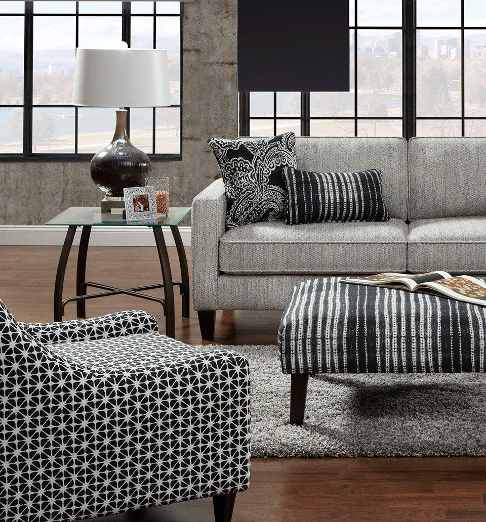 Mixing patterns in the living room with fusion furniture black and white paisley small print and stripes