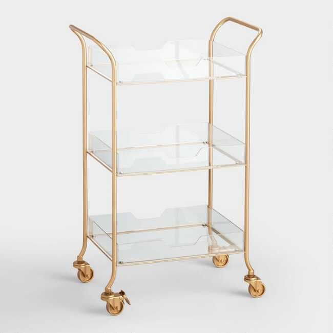 Our ultra chic rolling cart with transparent shelves and a sleek matte gold metal frame is sure to become your new favorite home organization piece. We adore its easy-to-move style and shelves perfectly sized for storing bar essentials, book or your collection of potted cacti.