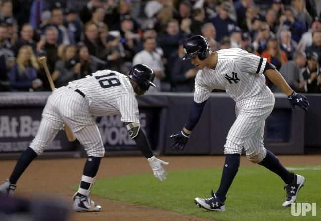 09339b44d86 New York Yankees right fielder Aaron Judge (99) celebrates with New York  Yankees shortstop Didi Gregorius (18) after his solo home run…