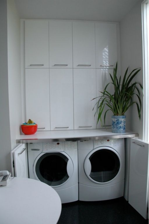 Hidden Laundry With Lower Front Loading Washer And Dryer