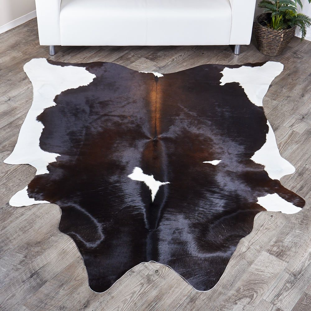 Our Brazilian Cowhides Are A Top Of The Line Natural Beauty These Rugs Can Be Styled To Add Contemporary And M Tricolor Cowhide Rug Cow Hide Rug Buying Carpet