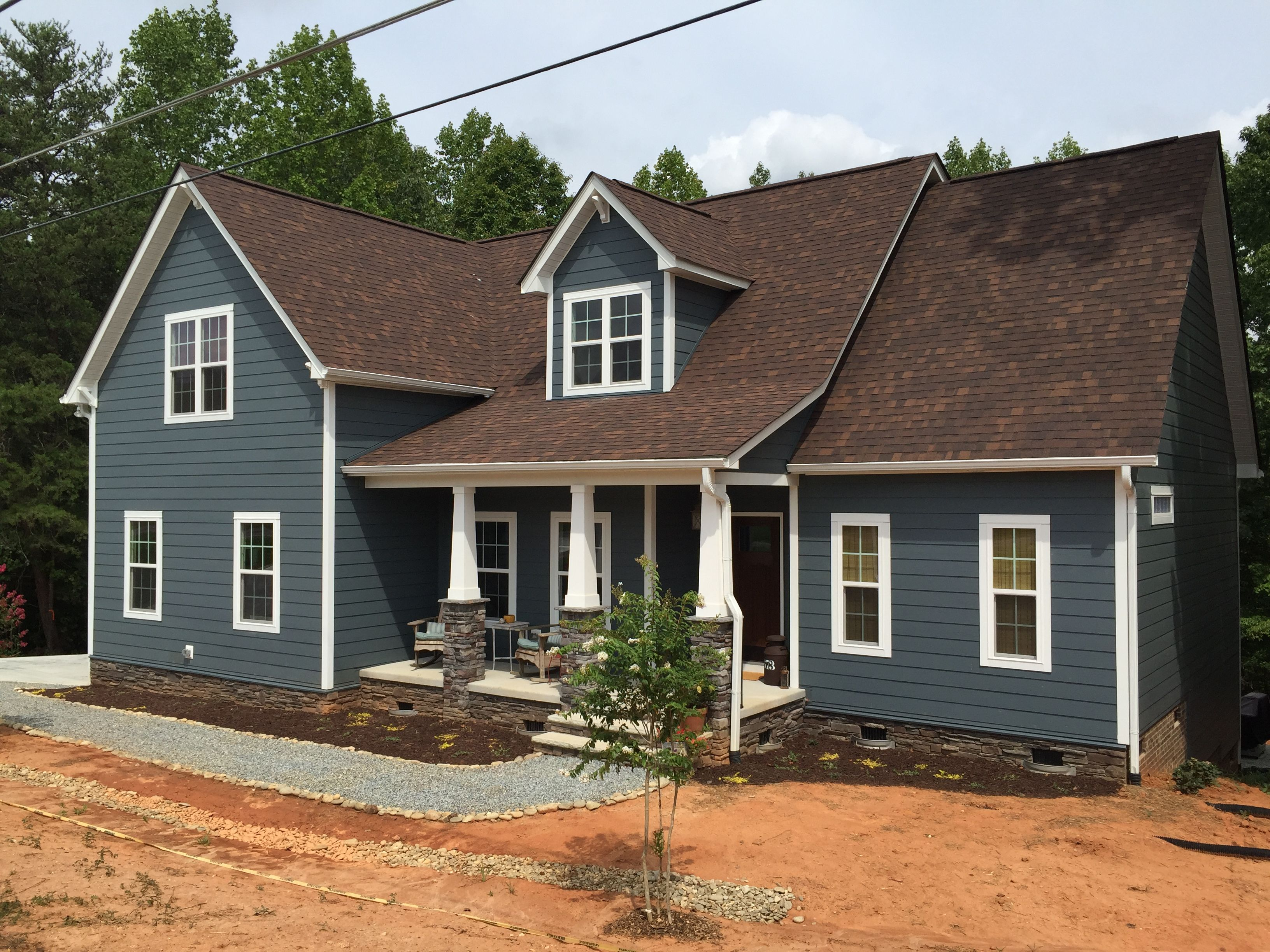 Blue Craftsman Home, James Hardie Evening Blue, Brown Roof, Ledgestone, Pea  Gravel Walkway