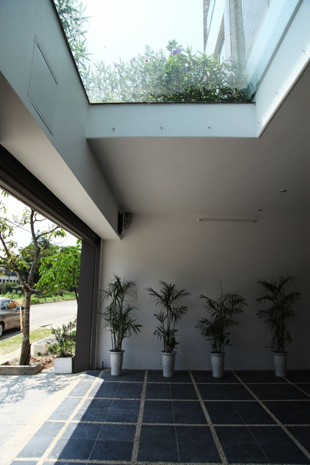 Skylight Above Car Porch Helps Brighten The Space Within Car