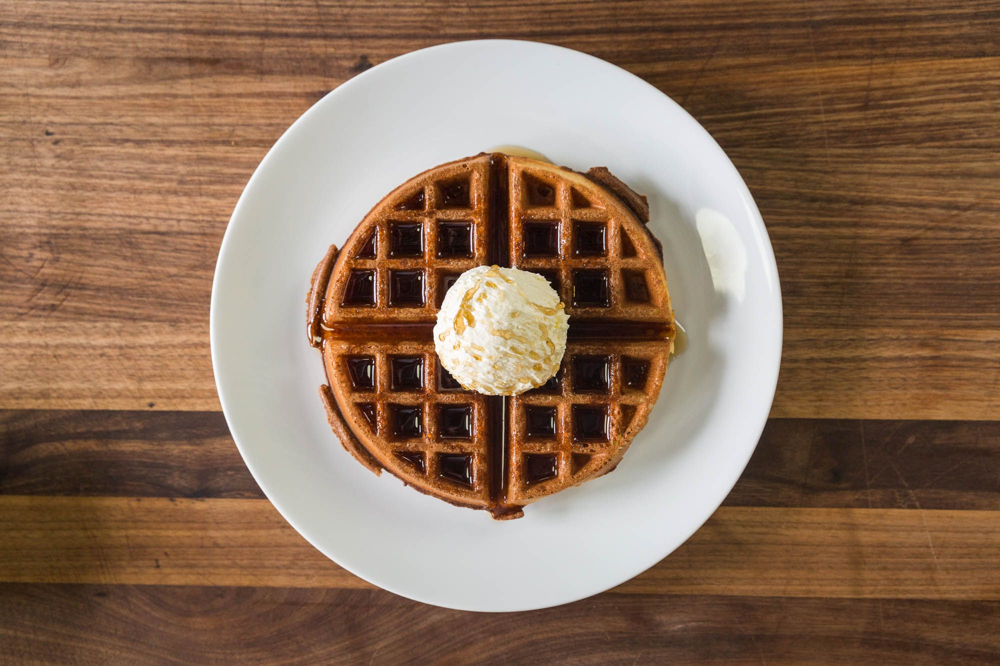 A hot, homemade waffle with butter and maple syrup. Pancakes vs. Waffles—which one is your favorite? Get the recipes: http://chfstps.co/1EmbAWw