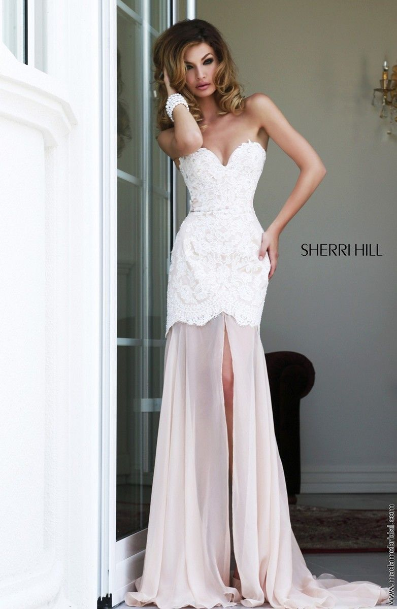 Lace tops the trumpet silhouette of sherri hill prom dress