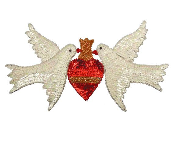 Pair of mirror image white birds doves with sacred heart sequin