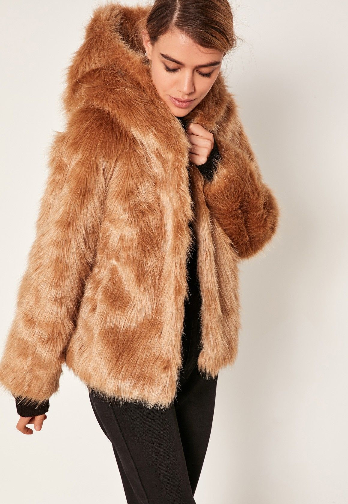 38b3def549af6d We love a faux fur coat here at Missguided and this caramel nude shade with  hood is top of our wish list.