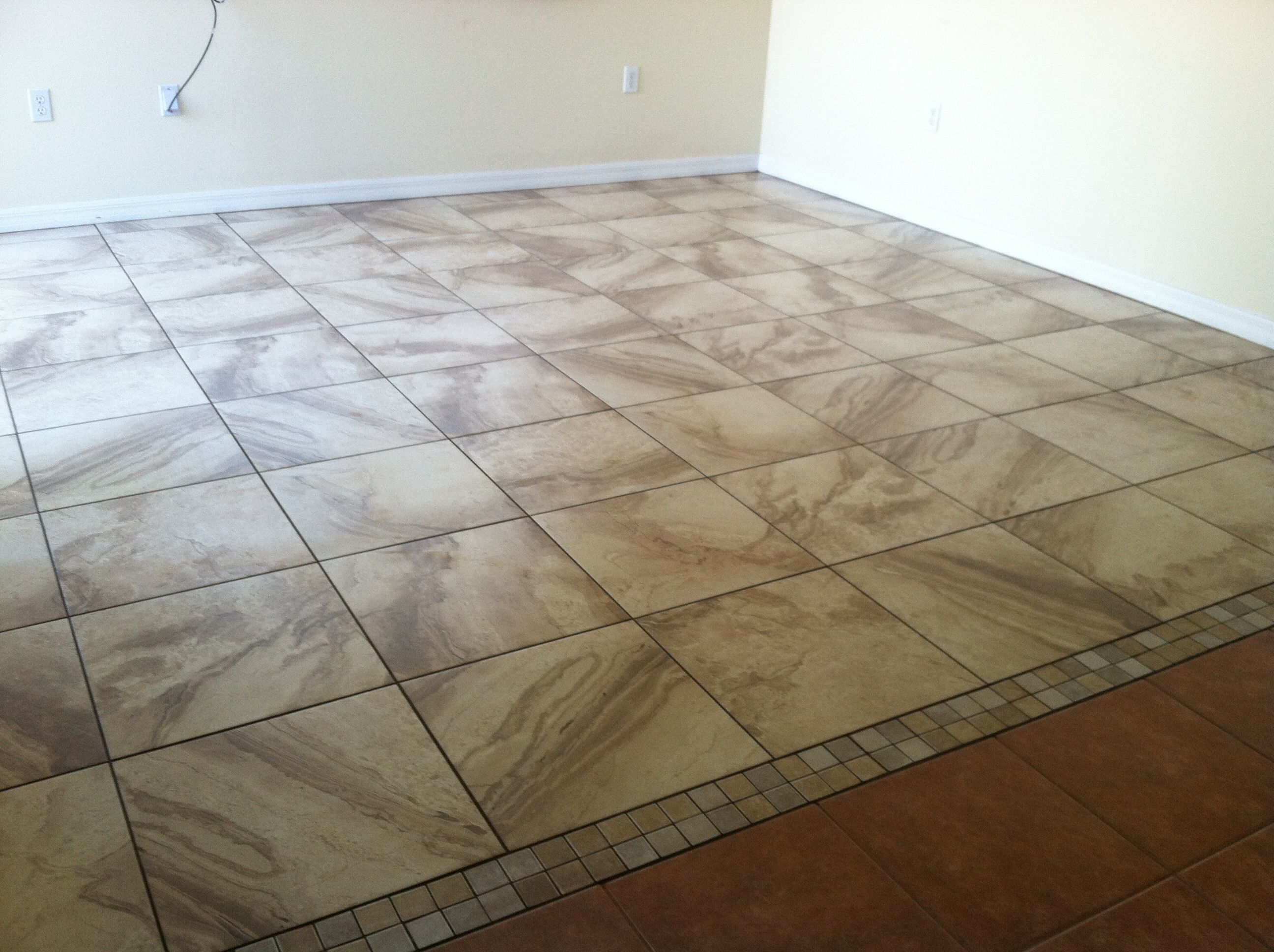 An Example Of A Transition Between Two Different Tiles Home Remodeling Tile Floor House Design
