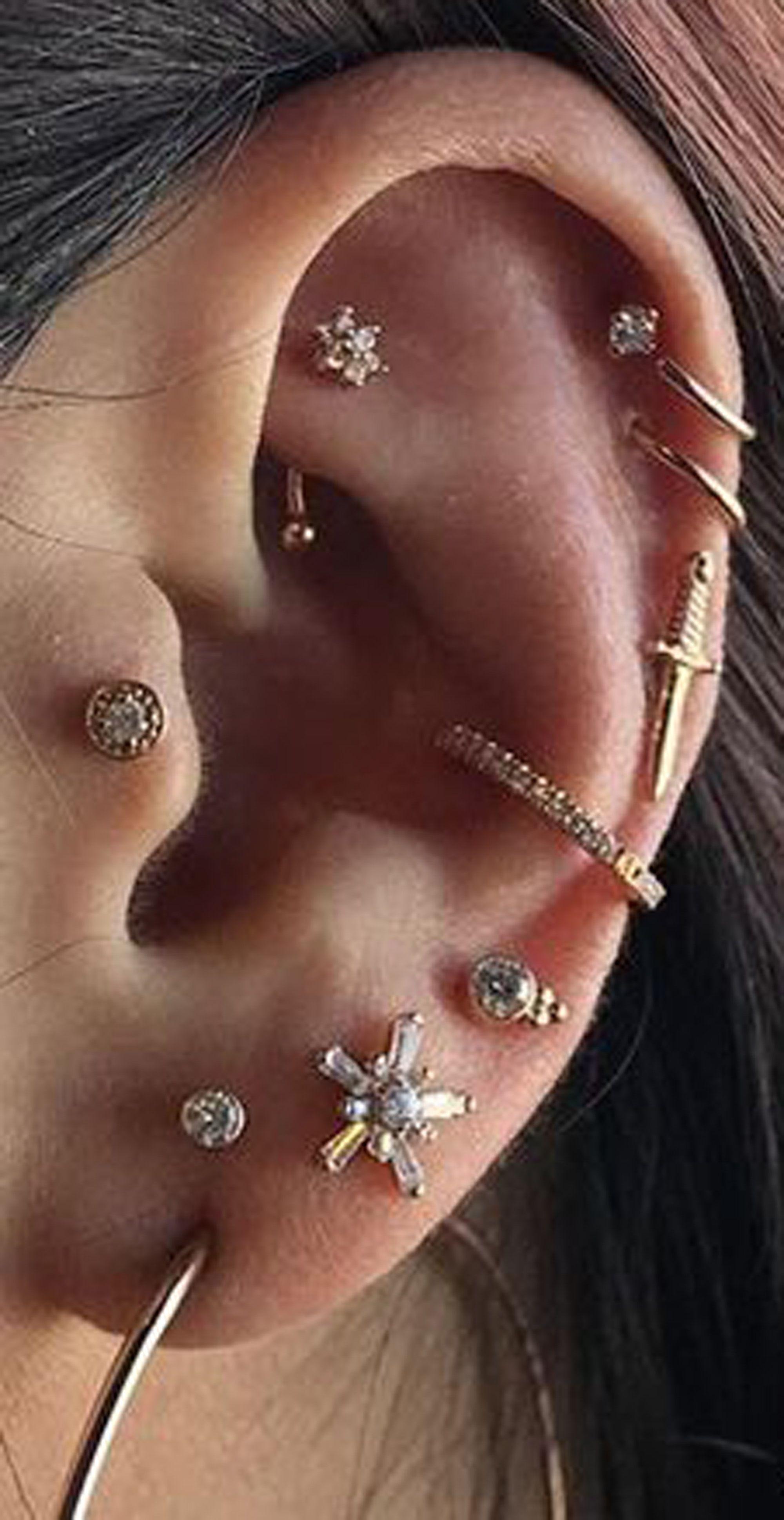 cute multiple ear piercing ideas for women flower rook jewelry conch ring hoop flower stud www.mybodiart.com #earpiercingideas