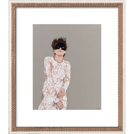 An eye-catching addition to your master suite or guest room, this stylish print by Artfully Walls showcases a woman motif and white boarder.