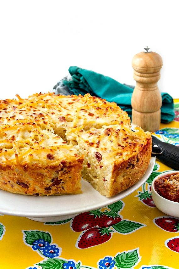 The best spaghetti pie is bucatini pie. Trust me, you will love this Italian comfort food rich with four cheeses and spicy with sopressata!